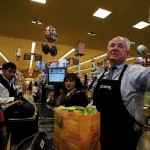 Los Angeles City Councilman Tom LaBonge bags groceries into reusable grocery bags at a Pavilions store.